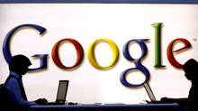 Google's shares are trading at only around 15 times its expected 2013 earnings, compared with a multiple of 32 times for Facebook. That implicit discount on Google's shares points to a lingering distrust that Wall Street has not yet been able to shake off, despite expectations that revenue will grow next year by more than a quarter to $54-billion and net profits by nearly a fifth to $14-billion. (Torsten Silz/The Associated Press)