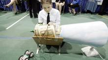 Katy Diederichs, 12, fine-tunes her science project that determines propeller efficiency at the 2009 Canada-Wide Science Fair in Winnipeg on May 12, 2009. (MARIANNE HELM FOR THE GLOBE AND MAIL)