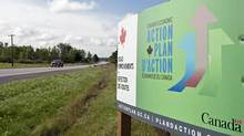 A highway sign advertising the Tory stimulus program, dubbed the Economic Action Plan. (Adrian Wyld/The Canadian Press/Adrian Wyld/The Canadian Press)