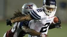 Toronto Argonauts Chad Owens runs past Montreal Alouettes Dwight Anderson during the first half of their CFL football game in Montreal, July 27, 2012. (CHRISTINNE MUSCHI/REUTERS)