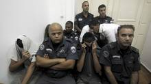 Israeli teenagers suspected of attacking a Palestinian while he was walking with an Israeli woman cover their faces during an arrest extension hearing at a Jerusalem court, Sunday, Sept. 9, 2012. (Mahmoud Illean/AP)