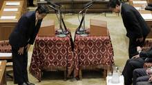 Japanese Prime Minister Yoshiko Noda, right, and opposition Liberal Democratic Party president Shinzo Abe bow to each other before their debate in parliament, Nov. 14, 2012. (Itsuo Inouye/AP)
