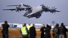 An Airbus A400M military transport plane takes off on its maiden flight in the Andalusian capital of Seville in this December 11, 2009 file photo. (MARCELO DEL POZO/REUTERS)