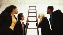 Business people looking up a ladder. (Stockbyte/Getty Images)