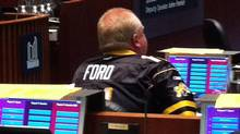 Mayor Rob Ford wears a yellow and black Hamilton Tiger-Cats jersey in Oct. 24's city council meeting.