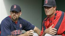 Boston Red Sox catcher Jason Varitek, left, talks with pitching coach John Farrell as they watch the field prior to a spring training baseball game against the Minnesota Twins in Fort Myers, Fla., Wednesday, March 28, 2007. (AP Photo/Charles Krupa) (Charles Krupa)