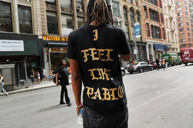 A fan wears a shirt from a Kanye West pop-up shop in Manhattan in August.