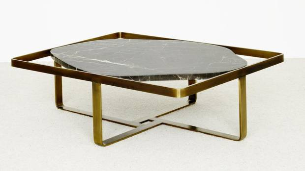 Disco design: The Jen coffee table, from Parisian furniture maker Christophe Delcourt, with its polished brass and chocolatey St. Laurent marble, is a sumptuous throwback to '70s glam. $14,375. Through avenue-road.com.