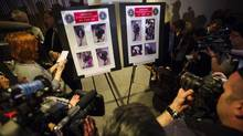 The FBI has released photographs and videos of two suspects in Monday's Boston Marathon bombing and is asking the public for help in identifying the two men. (LUCAS JACKSON/Reuters)
