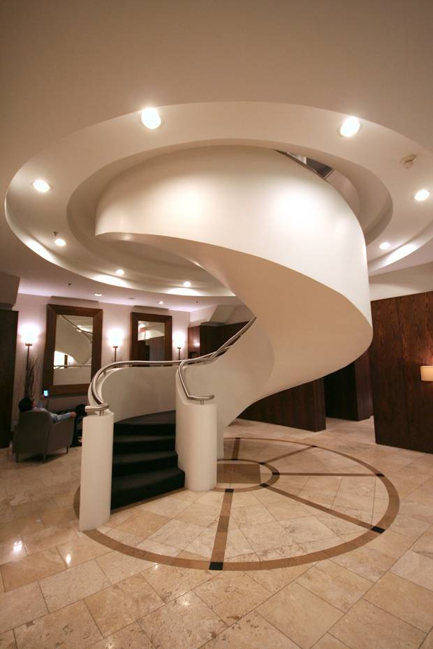 The curved staircase inside the lobby of The Morgan.