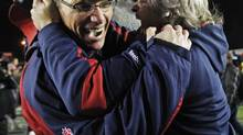 Montreal Alouettes coach Marc Trestman (left) celebrates their Grey Cup win with general manager Jim Popp after the Alouettes beat the Saskatchewan Roughriders to win the 97th Grey Cup in Calgary, Sunday November 29, 2009. (Adrian Wyld/The Canadian Press)