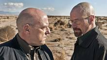 "This publicity image released by AMC shows Dean Norris as Hank Schrader, left, and Bryan Cranston as Walter White in ""Breaking Bad."" The series is returning for its eight final episodes starting Sunday at 9 p.m. EDT. The long-awaited showdown places Hank in direct conflict with the villainous hero, Walter White. (Frank Ockenfels/AP)"