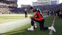 Denver Broncos quarterback Tim Tebow prays near the endzone prior to their NFL football game against the Chicago Bears in Denver December 11, 2011. (RICK WILKING/REUTERS)