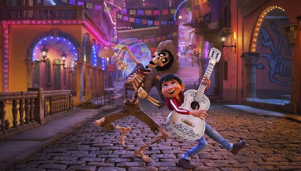 Miguel, voiced by Anthony Gonzalez, right, looks to Hector, voiced by Gael Garcia Bernal, to find the secret behind his family's ban on music in Coco.