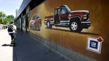 In downtown Oshawa, murals painted on the walls of the bus station depict the history and importance of GM to the city. (Peter Power/The Globe and Mail)
