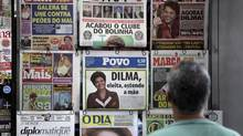 Top: Newspapers on display in Rio de Janeiro: More than 200-million of the world's 240-million Portuguese-speakers live in Brazil. Below: (Felipe Dana/Associated Press)