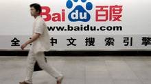A man walks past an advertisement for Baidu.com in Shanghai in this picture taken on August 4, 2005. (CHINA NEWSPHOTO)