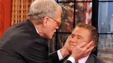 "In this image released by Disney-ABC Domestic Television, late night talk show host Dave Letterman, left, prepares to kiss his long-time friend, host Regis Philbin, during an appearance on ""Live! with Regis and Kelly,"" Wednesday, Nov. 16, 2011. (David Steele/David Steele / AP)"