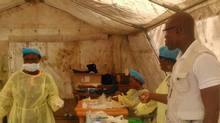 In this photo taken on Sunday, July 27, 2014, medical personnel work at the Doctors Without Borders facility in Kailahun, Sierra Leone where Dr. Sheik Humarr Khan died. (Youssouf Bah/AP)