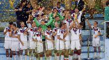 Germany celebrates after winning the World Cup final soccer match between Germany and Argentina at the Maracana Stadium in Rio de Janeiro, Brazil, Sunday, July 13, 2014. (Fabrizio Bensch/AP)
