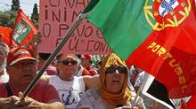 People shout slogans during a rally calling for new general elections near the Portuguese presidential palace in Lisbon on July 6, 2013. (JOSE MANUEL RIBEIRO/REUTERS)