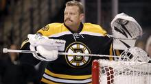 In this February 2012 photo, Boston Bruins goalie Tim Thomas gets ready for an NHL hockey game between the Bruins and the Pittsburgh Penguins in Boston. (Winslow Townson/AP)
