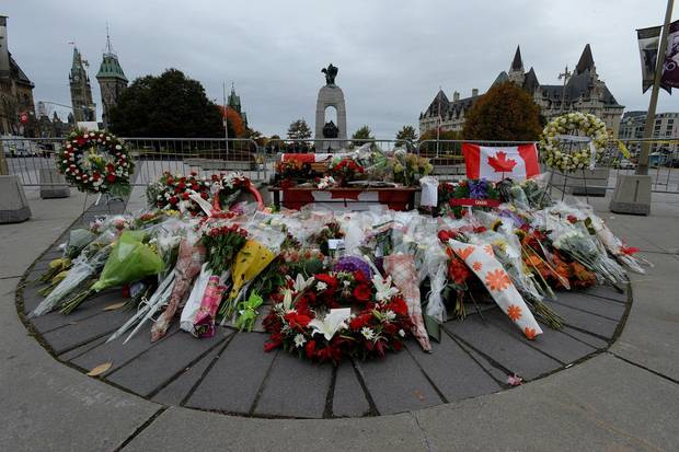 Floral tributes to slain Canadian Corporal Nathan Cirillo sit at the National War Memorial in Ottawa on Oct. 23, 2014.