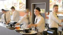 Busy waiter and waitresses working at a bar. (THINKSTOCK)