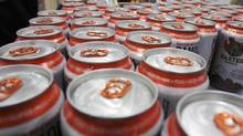 In this Thursday, Jan. 26, 2011 photo, cans of beer are sorted at the Baxter Brewing Co., in Lewiston, Maine. (Pat Wellenbach/The Associated Press)