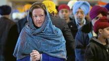 Alberta PC party leader Alison Redford makes a campaign stop at a Sikh temple in Calgary, Alta., Sunday, April 15, 2012. Albertans go to the polls on April 23. (Jeff McIntosh/The Canadian Press/Jeff McIntosh/The Canadian Press)