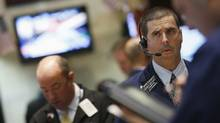 Traders work on the floor of the New York Stock Exchange May 31, 2012. (BRENDAN MCDERMID/REUTERS/Brendan McDermid)