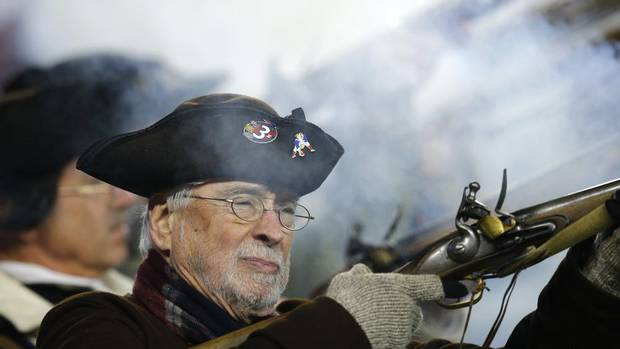 A member of the New England Patriots End Zone Militia fires a gun after the Patriots defeated the Houston Texans in their NFL AFC Divisional playoff football game in Foxborough, Massachusetts January 13, 2013. (BRIAN SNYDER/REUTERS)