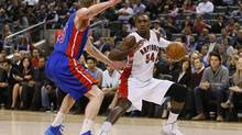 Toronto Raptors forward Patrick Patterson (54) looks to make a play as Detroit Pistons forward Kyle Singler (25) defends during the first half at the Air Canada Centre. (John E. Sokolowski/USA Today Sports)