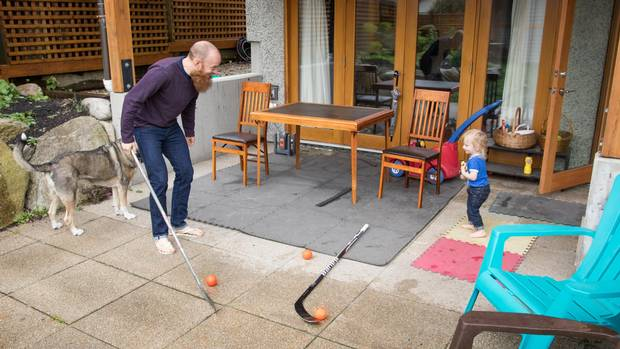 Robbins plays hockey on the patio with his 20-month old son, Reed.