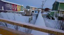 Inuvik, NWT, is seen in December, 2013. Figures show the Northwest Territories' population dropped slightly last year as the cost of a significant loss of revenue such as income tax. (PETER POWER/THE GLOBE AND MAIL)