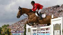 Canada's Eric Lamaze rides Derly Chin De Muze during the equestrian individual jumping third qualifier in Greenwich Park at the London 2012 Olympic Games on Monday. (MIKE HUTCHINGS/REUTERS)