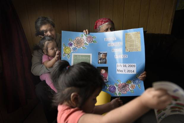Wawa Keno and her mother-in-law Adelaide Meekis look at posters and signs made for her son Brody.