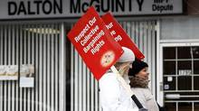 Striking public elementary school teachers protest outside Premier Dalton McGuinty's constituency office in Ottawa. (CHRIS WATTIE/REUTERS)