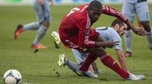 Toronto FC 's Doniel Henry (left) and Sporting Kansas City's Benny Felhaber battle for the ball during first half MLS action in Toronto on Saturday September 21, 2013. Toronto FC will soon face D.C. United. (Chris Young/THE CANADIAN PRESS)
