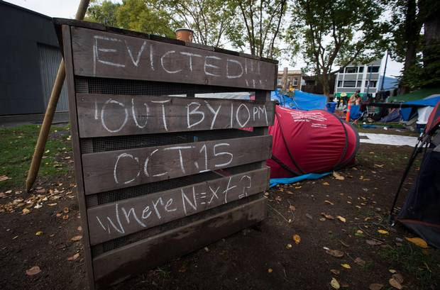 A notice about the eviction is written at the tent city at Oppenheimer Park.
