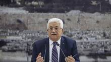 Palestinian leader Mahmoud Abbas signed 'State of Palestine' applications for 15 United Nations agencies. (Majdi Mohammed/Associated Press)