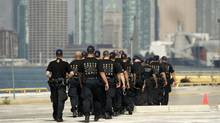 Police officers march in preparation for G-20 summit at the old ferry terminal on Cherry Beach in June, 2010. (Fernando Morales/The Globe and Mail/Fernando Morales/The Globe and Mail)