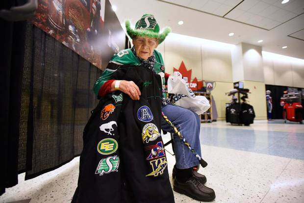 Saskatchewan Roughrider fan Ethel Mongovius, 85, taking a break after shopping at the Grey Cup store in the South Building, Metro Toronto Convention Centre on Nov 24 2016. Ethel, showing her jacket covered in crests from every CFL team except the Ottawa RedBlacks. and her family came from Saskatoon, Saskatchewan for the 104th Grey Cup game between the Calgary Stampeders and the Ottawa RedBlacks. Ethel has been going toGrey Cup games since retiring in 1996. Many of the fans attending the game will be Roughrider fans who make the trek every year.