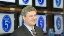 Prime Minister Stephen Harper smilles during a GST reduction announcement in Mississauga, Ontario on Monday Dec. 31, 2007. (Frank Gunn/THE CANADIAN PRESS)