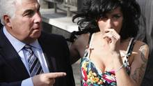 "Amy Winehouse, right, arrives with her father, Mitch, at Westminster Magistrates Court in London, Tuesday, March 17, 2009. Mitch Winehouse has written a memoir titled ""Amy, My Daughter."" (Kirsty Wigglesworth/AP)"