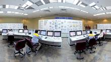 Russian and Iranian operators monitor the nuclear power plant unit in Bushehr, about 1,215 kilometres south of Tehran. (Mehdi Ghasemi/Reuters/Mehdi Ghasemi/Reuters)