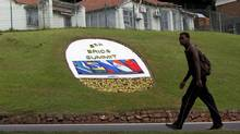 A man walks past a floral display announcing the 5th BRICS Summit in Durban, March 25, 2013. (ROGAN WARD/Reuters)