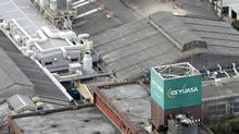 "A company name is seen atop the headquarters of GS Yuasa Corp., the maker of lithium-ion batteries used in Boeing 787 ""Dreamliner,"" in Kyoto, western Japan as Japanese and U.S. investigators conduct a probe of the maker Monday, Jan. 21, 2013. (AP)"