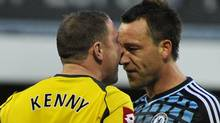 Queen's Park Rangers's goalkeeper Paddy Kenny (L) and Chelsea's John Terry confront each other during their English Premier League soccer match at Loftus Road in London October 23, 2011. REUTERS/Toby Melville (Toby Melville/REUTERS)