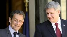 French President Nicolas Sarkozy and Prime Minister Stephen Harper leave the Elysee Palace in Paris on Friday, June 4. (LIONEL BONAVENTURE/Lionel Bonaventure/AFP/Getty Images)